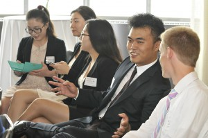 First-year Master's students converse during a break at the School of Tourism and Hospitality Management's New Master's Orientation. Credit: Jim Roese
