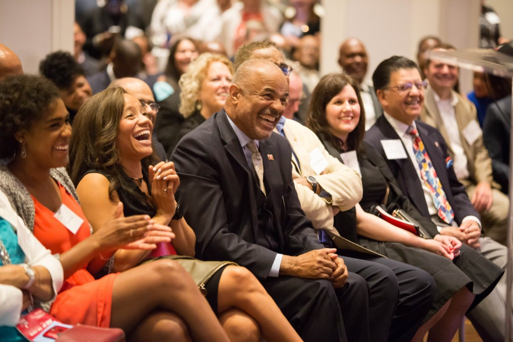 Associate Vice Dean Jeffrey Montague lets out a laugh while listening to a speaker during his Roast and Toast.