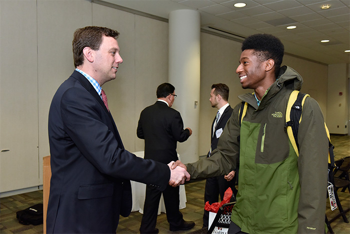 Whistle Sports Network CEO Brian Selander answers a question from a School of Sport, Tourism and Hospitality Management student following Selander's presentation as STHM Executive in Residence.